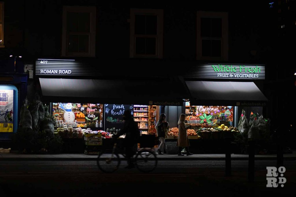 Christmas shopfront at Whole Fresh, Roman Road, by photographer Phil Verney