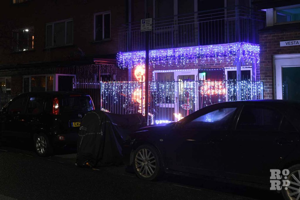 House in Bow with icyle festive lights, by photographer Phil Verney