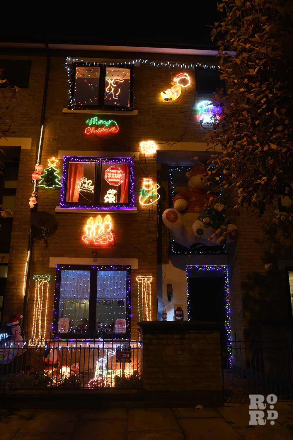 A house in Bow completely decorated in festive lights and figures by photographer Phil Verney