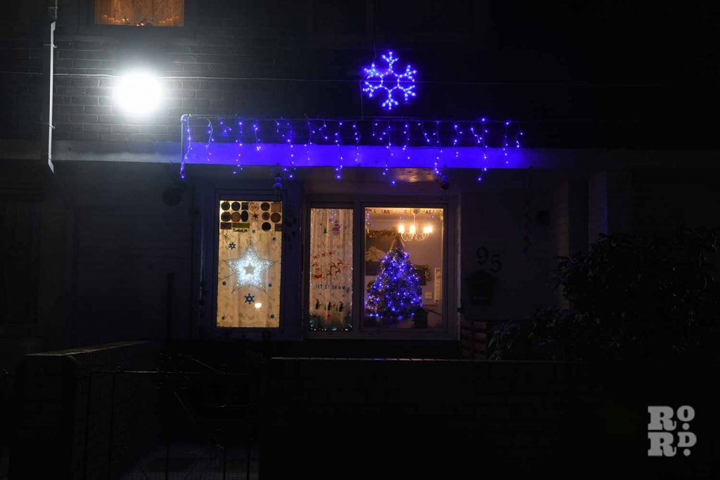 Blue festive lights on a house in Bow, by photographer Phil Verney
