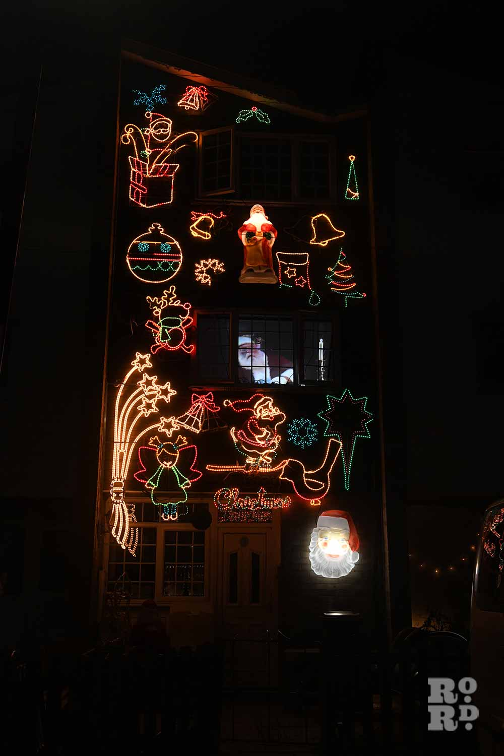 A house covered in illuminated festive shapes in Bow, by photographer Phil Verney