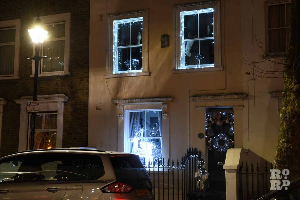 Cool white festive window around windows and front door in Bow, by photographer Phil Verney