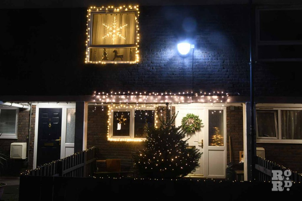 Chrismtas lights and tree outside a house in Bow, by photographer Phil Verney