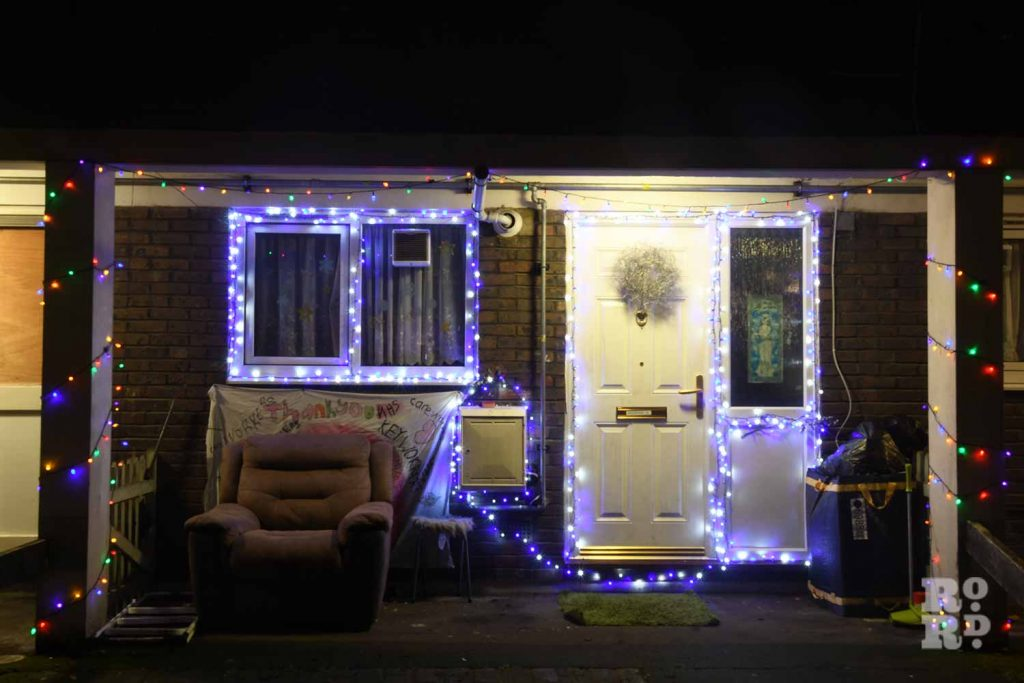 House decorated with Chrismas lights and an armchair, by photographer Phil Verney