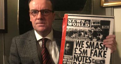 Gary Hutton, author of Product of a Postcode, holding newspaper clipping from News of the World