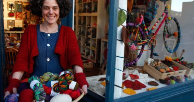 Owner of Wild and Wooly standing outside her knitting supplies shop on Lower Clapton Road