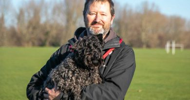 Douglas Thackway with his dog Martha, in Victoria Park, East London