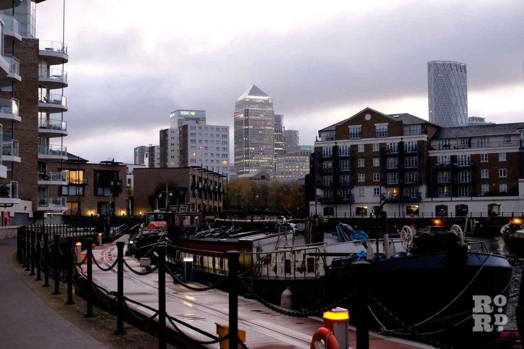 Canary Wharf looms over the canal