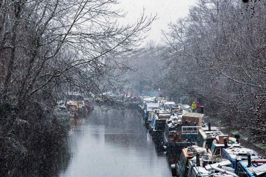 Snowy barges on Regent's Canal, Victoria Park, 2021