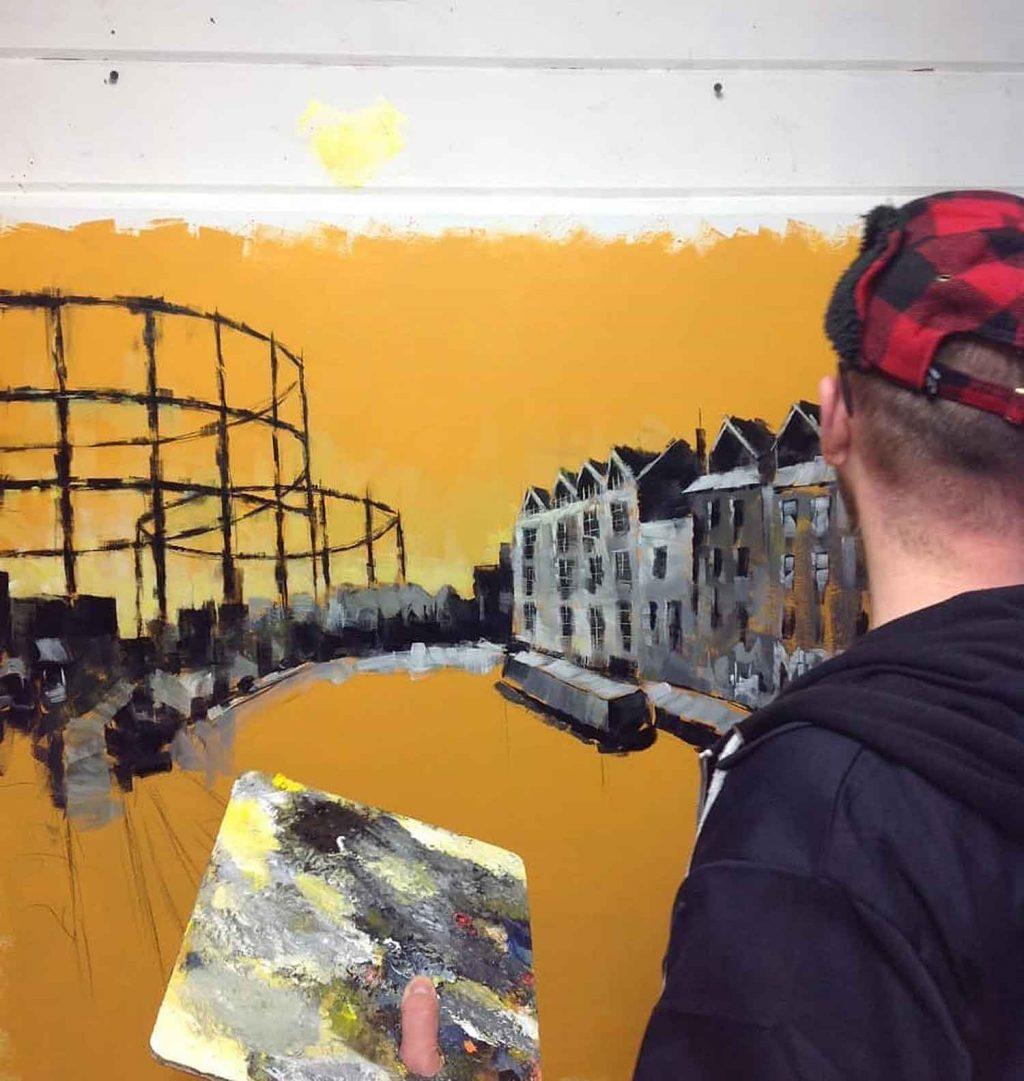 Painting in his studio, artist Marc Gooderman