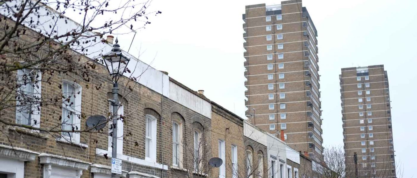 Victorian terraced street in Bow with tower blocks in the distance