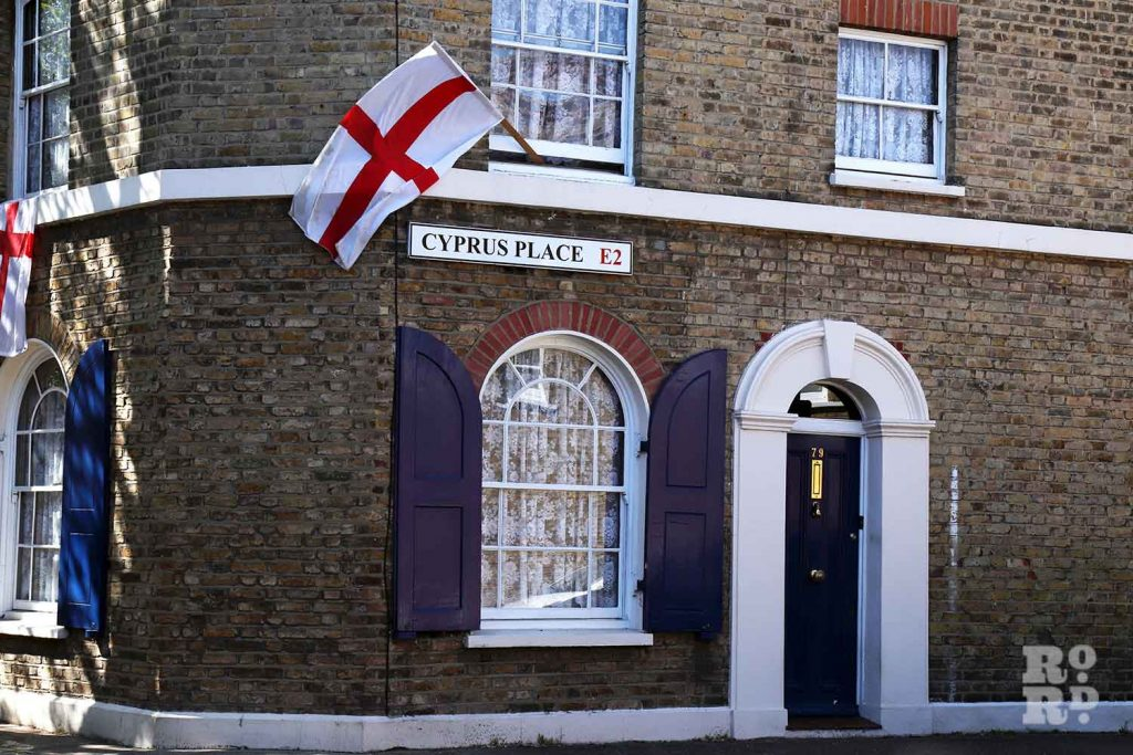 English flags flying, St George's Day, Cyprus Street in Bethnal Green, East London.