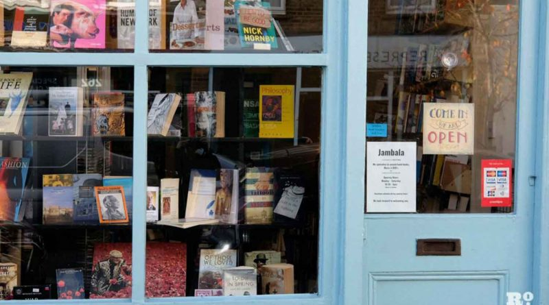 The blue-painted shopfront of Jambala Bookshop, Globe Road, Roman Road, Bethnal Green.