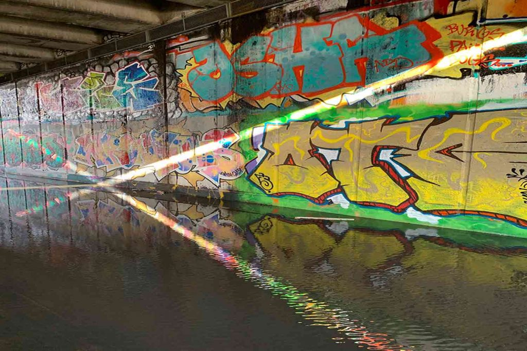 Reflections under the canal bridge, photo by Hackney Wick Creatives.