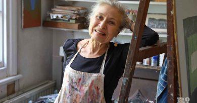 A portrait of Bow artist Alice Sielle, wearing her artist smock.