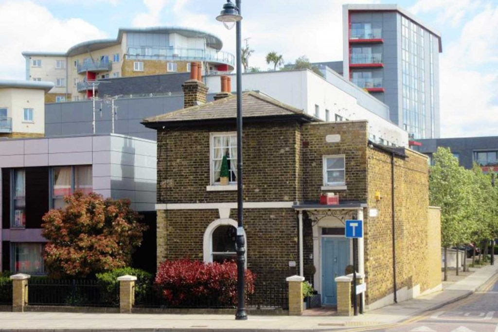 Pelican Cottage with new Mojo Housing tower blocks in the background, Fairfield Road, Bow, 2010s.