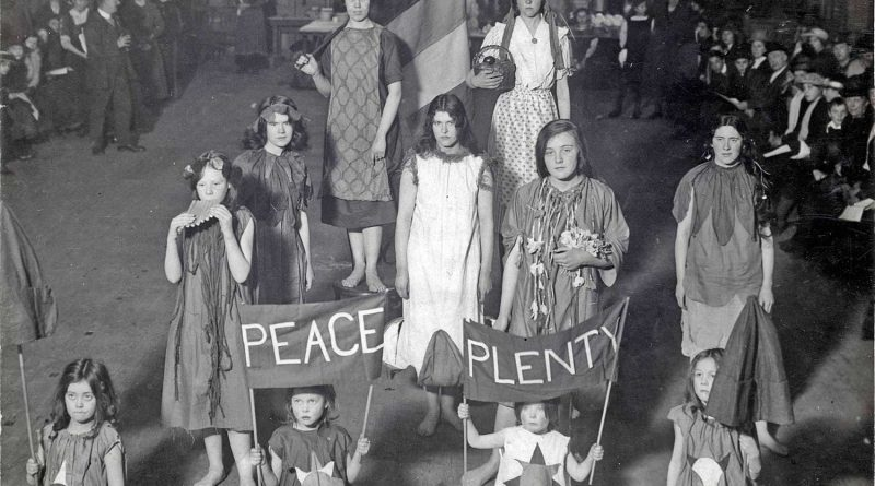 The Junior Suffragettes at the East London Federation of Suffragettes' New year party at Bow baths, East London, in 1916. Middle row, left, sixteen-year-old Rose Pangelly plays the panpipes.