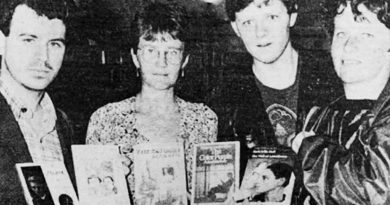 Black and white newspaper image of Chief librarian Anne Cunningham (centre left) receiving the books including The Colour Purple, with campaigner Paul Barlow (left).