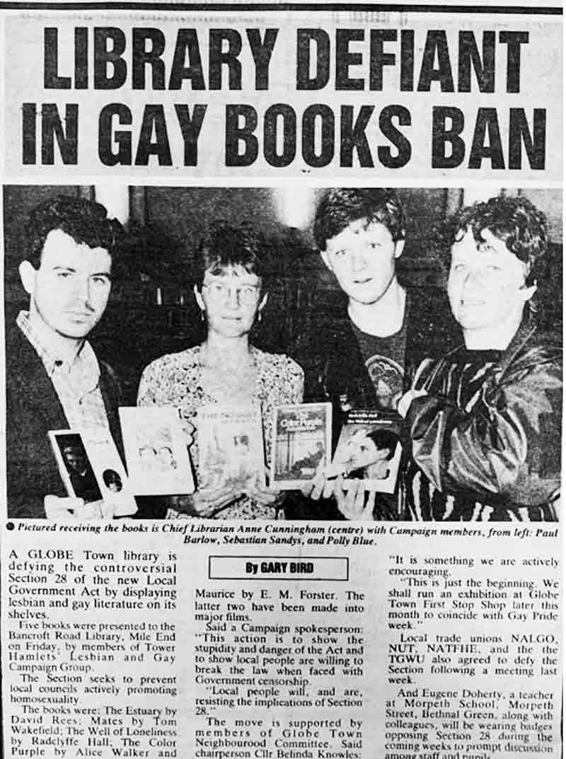 Black and white newspaper image of Chief librarian Anne Cunningham (centre left) receiving the books including The Colour Purple, with campaigner Paul Barlow (centre right).