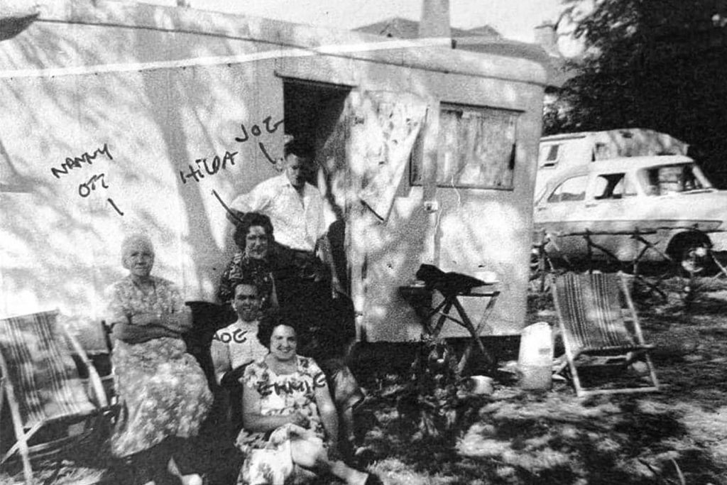 A family stands in front a caravan on the Isle of Sheppey, a favourite East End seaside destination