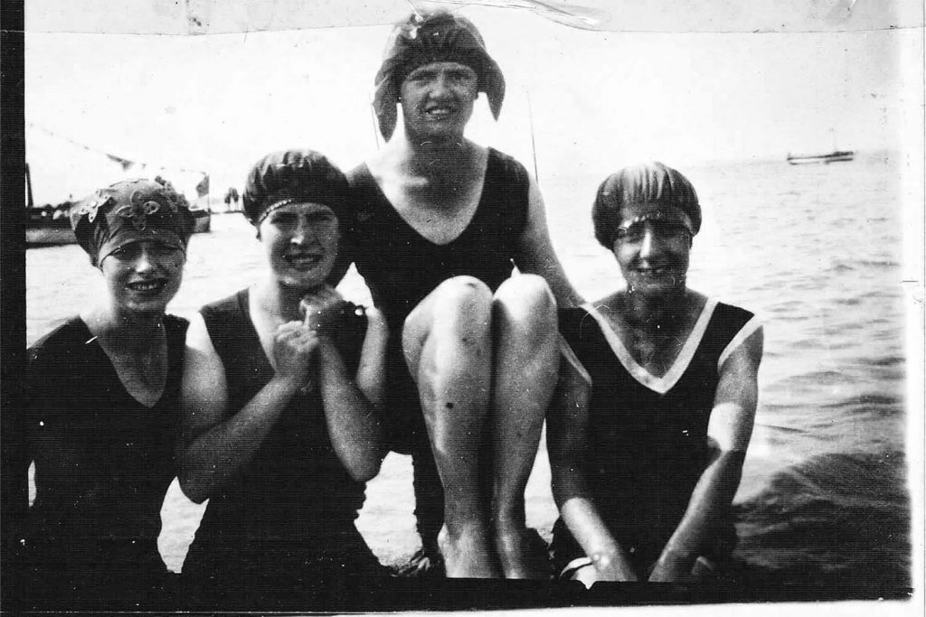 Four girls bathing in the sea on the Isle of Sheppey, an East End seaside holiday destination