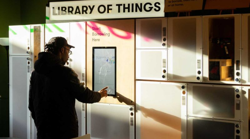 Borrower accessing kiosk at Library of Things, opening in Hackney Wick.