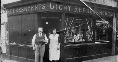 Luigi and Francesca Randolfi stand outside Randolfi's Café in a black-and-white photograph taken around 1930