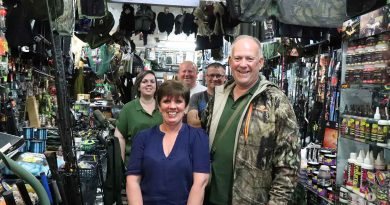 Owners Sharon and Terry Langston with the team at Roman Tackle, Roman Road.