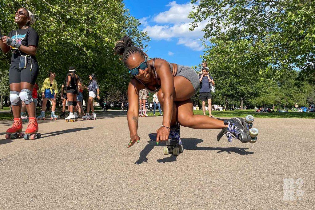 Roller skater doing a trick, Victoria Park, East London.