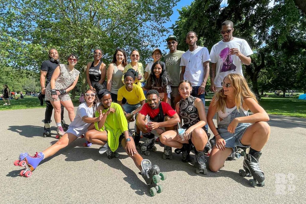 A group of roller skaters pose together, Victoria Park, East London.