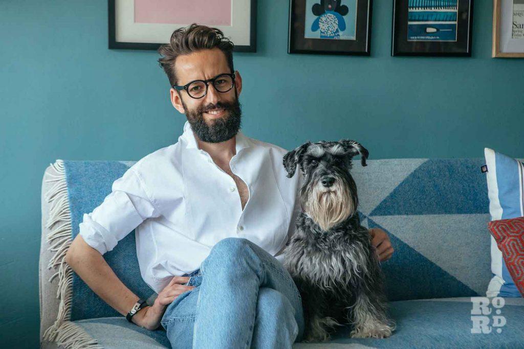 Man and dog, stylist Wojtek van Portek in his Bow home.