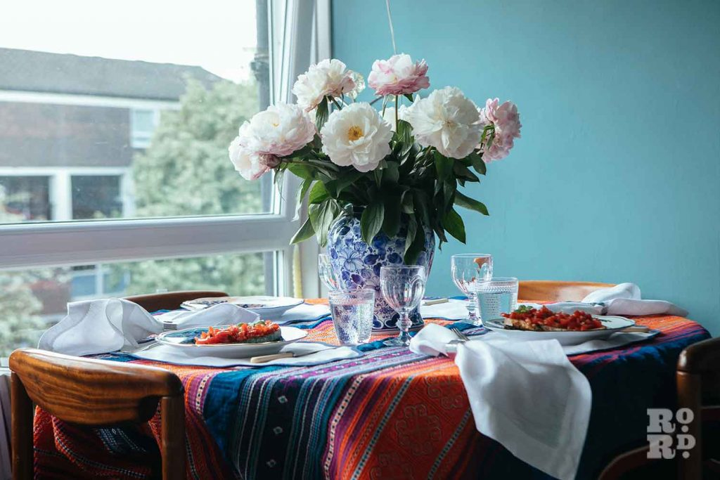 Lunch served with floral centrepiece, stylist Wojtek van Portek in his Bow home.