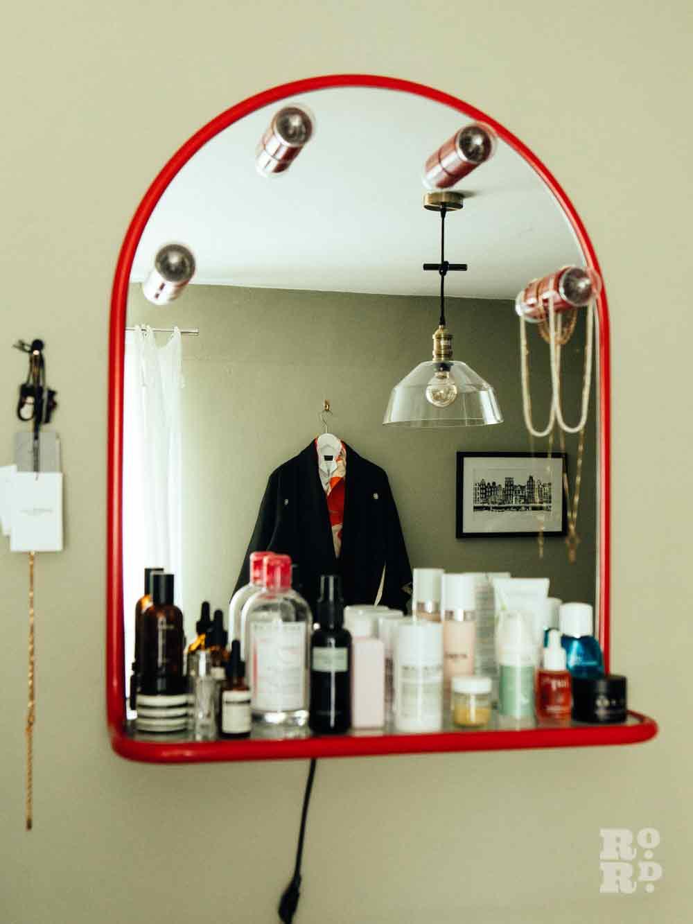 Bedroom mirror and shelf, stylist Wojtek van Portek in his Bow home.