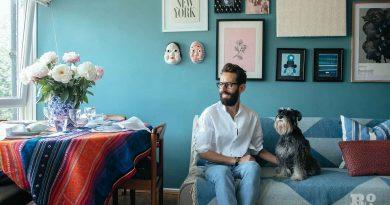 Sitting with his schnauzer, stylist Wojtek van Portek in his Bow home.