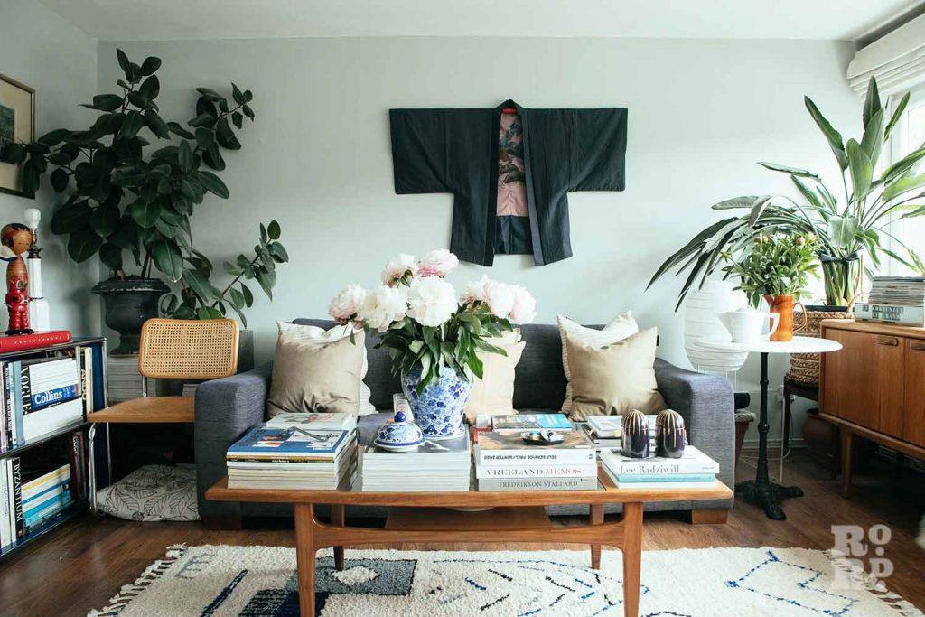 Kimono pinned to wall above sofa, stylist Wojtek van Portek in his Bow home.