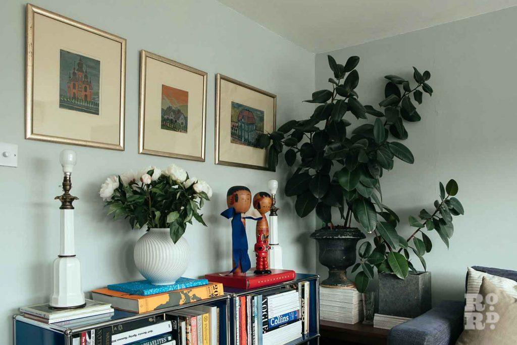 A large plant dominates the corner of a living room, stylist Wojtek van Portek in his Bow home.