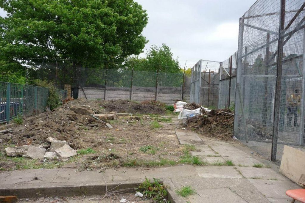 Disused and empty plot of land at the Canal Club Community Garden