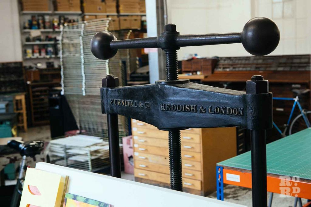 The metal handle of a printing press at the London Centre for Book Arts