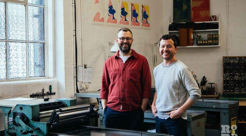 Simon Goode and Ira Yonemura stand next to a printing press at London Centre Book Arts