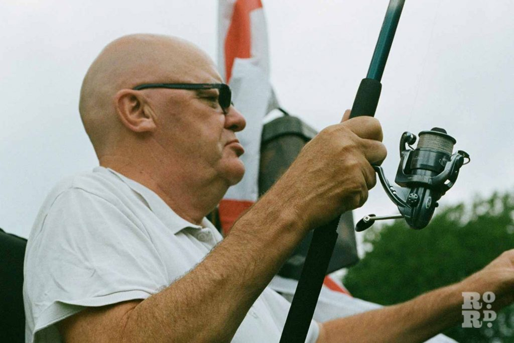 Chris Kimberley, fishing in Victoria Park, East London.