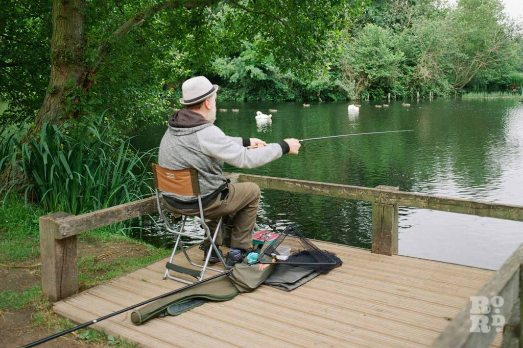 Bernie Wighton fishing in Victoria Park, East London.