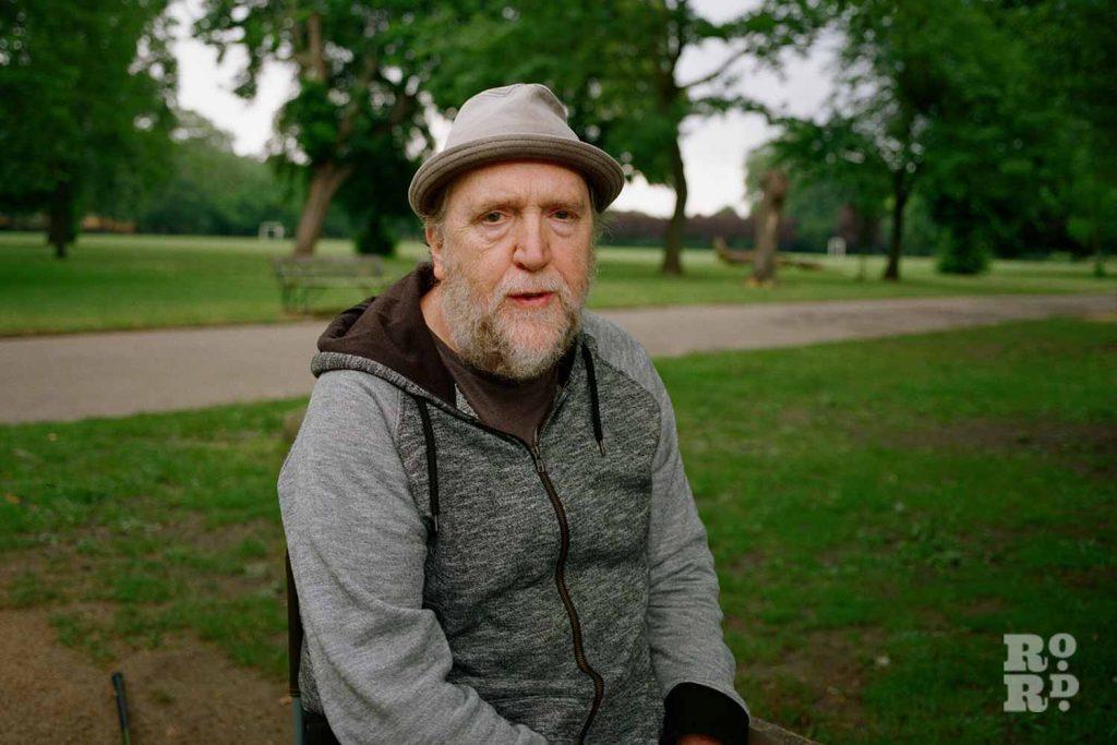 Bernie Wighton sat in Victoria Park, East London.