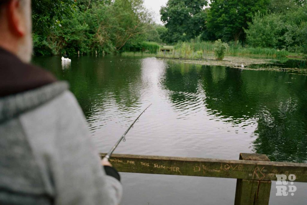 Fishing rod, fishing in Victoria Park, East London.