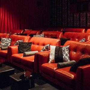Red leather sofas at Studio 4, Genesis cinema, East London.