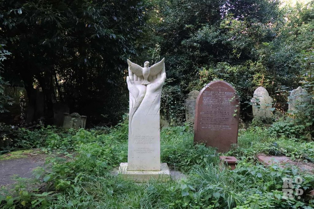 A pair of hands cradling a sparrow, memorial to Dr Barnardos' children, in Tower Hamlets Cemetery Park, East London