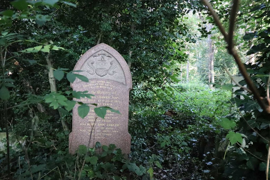 The Emblem of the Watermen and Lightermen, amongst foliage in Tower Hamlets Cemetery Park, East London